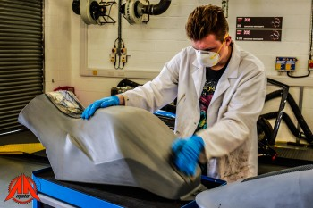 During our visit, the team was finishing the new two-pieces fairing in composite materials.